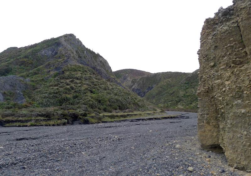 Image #Then entrance to Thrust Creek, with gravels in the cliff on the right. J.Thomson / GNS Science